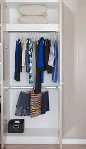 white wardrobe with clothes hanging at home