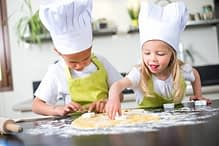 young kids happy childrens family preparing funny cookies in kitchen at home