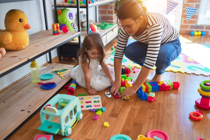 Mom and child controlling toy clutter