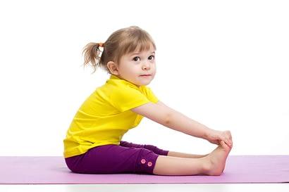 Child girl doing gymnastic exercises